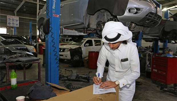 MEC inspection in progress at an auto garage in the Industrial Area.