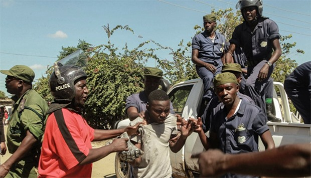 Zambian Police apprehend an alleged looters