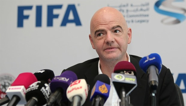 FIFA President Gianni Infantino listens to journalists' questions during a press conference in Doha
