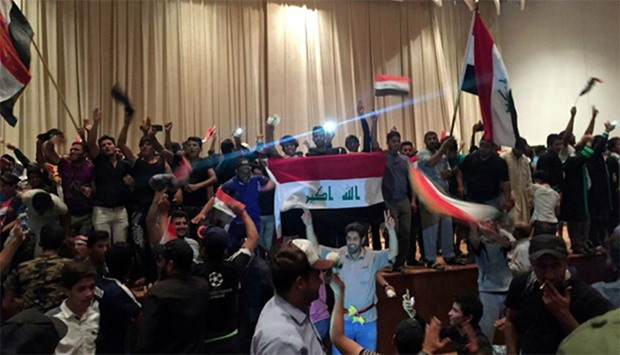 Followers of Iraq's Shia cleric Moqtada al-Sadr are seen in the parliament building as they storm Ba