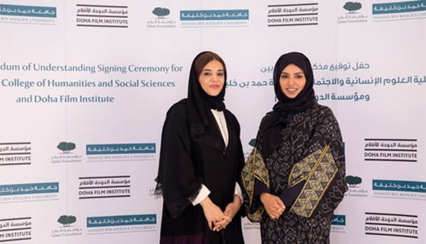 Dr Amal al-Malki and Fatma al-Rumaihi after the signing ceremony.