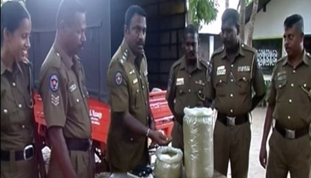 Sri Lanka police inspect seized packages of drugs