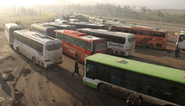 Buses carrying people from government-held Fuaa and Kafraya arrive in rebel-held Rashidin