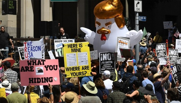 """Protestors take part in the """"Tax March"""" calling on US President Donald Trump to release his tax reco"""