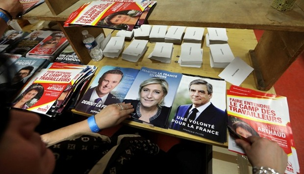 Civil servants prepare electoral documents for the upcoming French presidential election in Nice