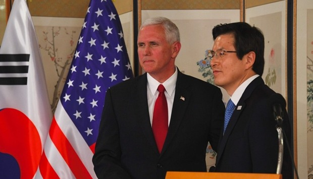 US Vice President Mike Pence (L) shakes hands with South Korea's Prime Minister and Acting President