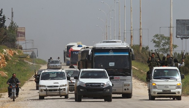 A convoy of buses carrying Sunni rebels and civilians, who were evacuated from Zabadani and Madaya