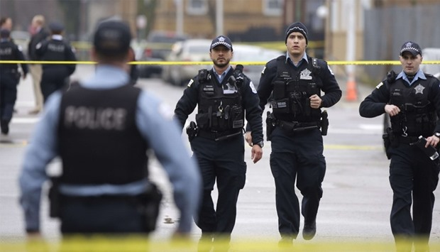 Chicago Police officers walk near the scene