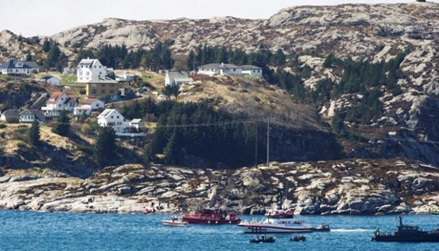Rescuers work at the site where the helicopter has crashed, west of the Norwegian city of Bergen on