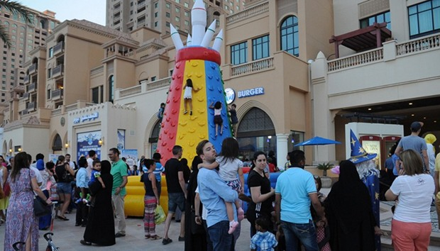 Inflatable play areas along a stretch of the Porto Arabia boardwalk.