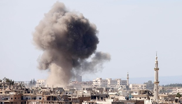 Smoke billows following reported air strikes