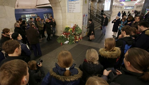 People mourn next to memorial site for victims of blast in St. Petersburg metro