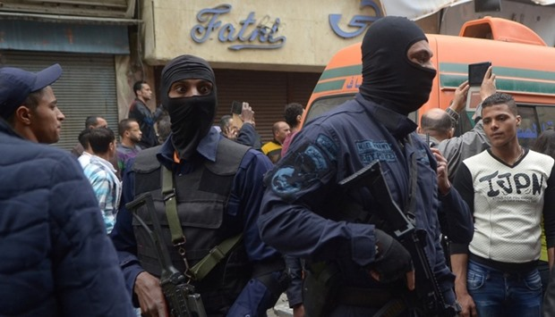 Egypt's special forces members take position after an attack by a suicide bomber in front of a churc