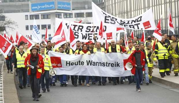 Members of German public sector workers union Verdi stage a strike at the airport in demand for high