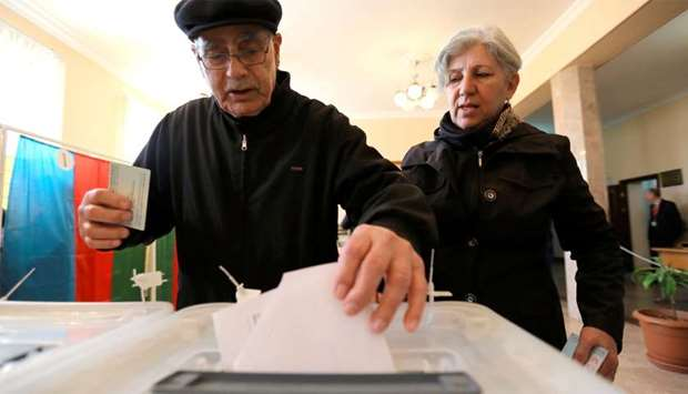 A man casts his vote during the presidential election in Baku, Azerbaijan