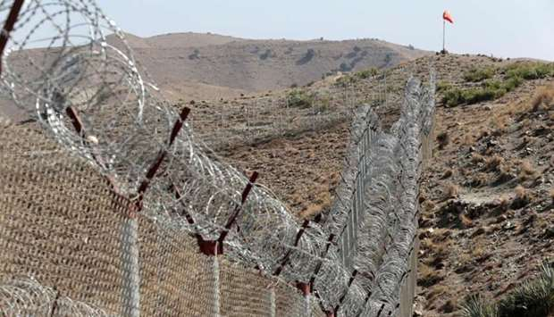 A view of the border fence outside the Kitton outpost on the border with Afghanistan in North Waziri