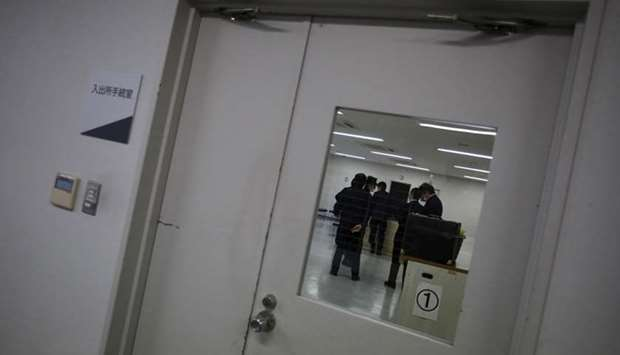 Guards at the East Japan Immigration Center stand inside a processing room at the center in Ushiku
