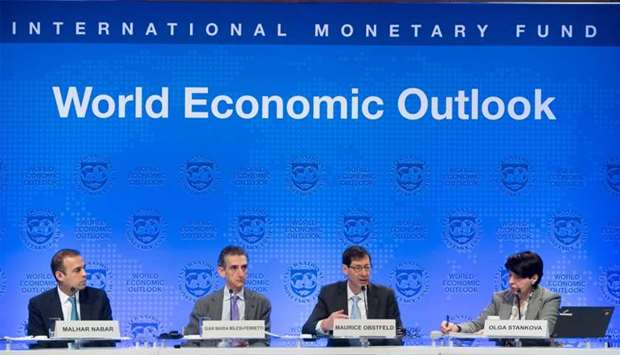 Maurice Obstfeld (2nd R), Economic Counsellor and Director of the Research Department at the IMF; Gi