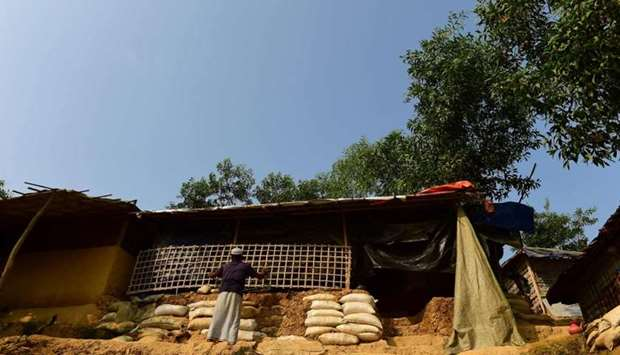 Rohingya refugee repairing his makeshift shelter at Kutupalong refugee camp in Bangladesh's Ukhia di