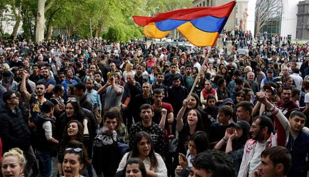 Armenians wave the national flag during an opposition rally in central Yerevan