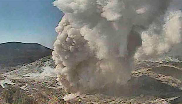 A video grab from the Japan Meteorological Agency's live camera image shows Io Yama erupting in Miya