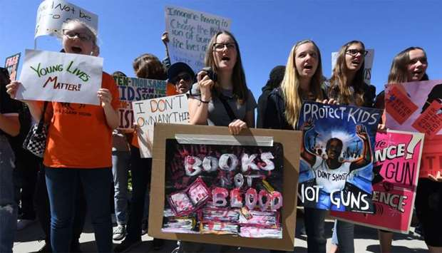Students from the Santa Monica area participate in a walkout demonstration as part of the National S
