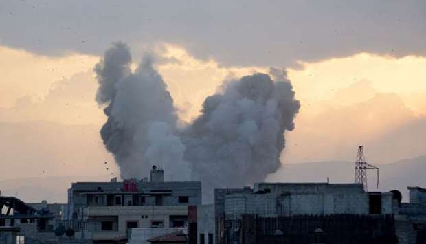 Smoke billows in a southern district of the Syrian capital Damascus, during regime strikes targeting