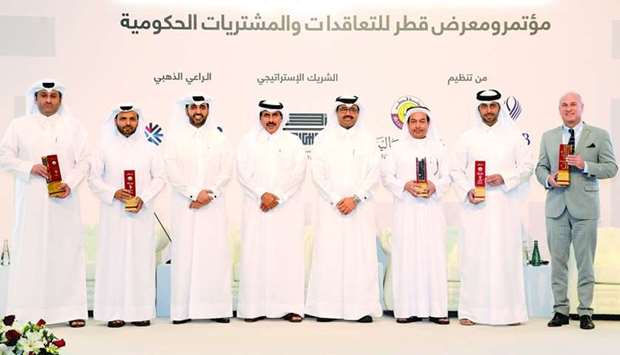 HE al-Sada, HE Sheikh Abdulla and al-Khalifa with the winners of National Procurement Awards at the