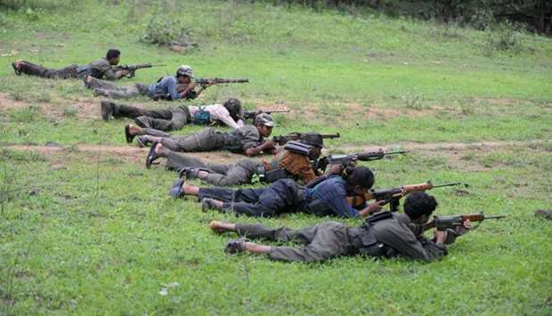 Indian Maoists ready their weapons as they take part in a training camp in Bijapur  on July 8, 2012.