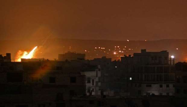 A picture taken in the Yarmuk Palestinian refugee camp in southern Damascus shows fire billowing in