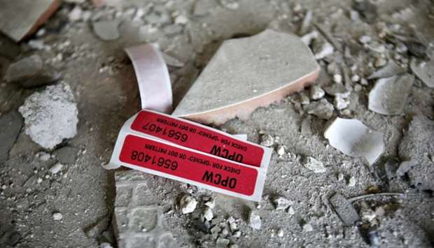 Labels of  OPCW are seen inside a damaged house in Douma in Damascus, Syria