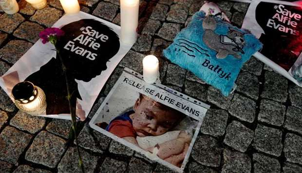 Candles and placards are pictured during a protest in support of Alfie Evans, in front of the Britis