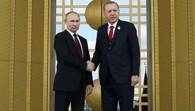 Erdogan, (R) shakinghands with his Russian counterpart Putin (L) during a welcoming ceremony at the