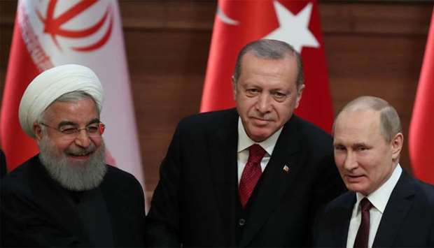 Presidents Hassan Rouhani of Iran, Tayyip Erdogan of Turkey and Vladimir Putin of Russia hold a join