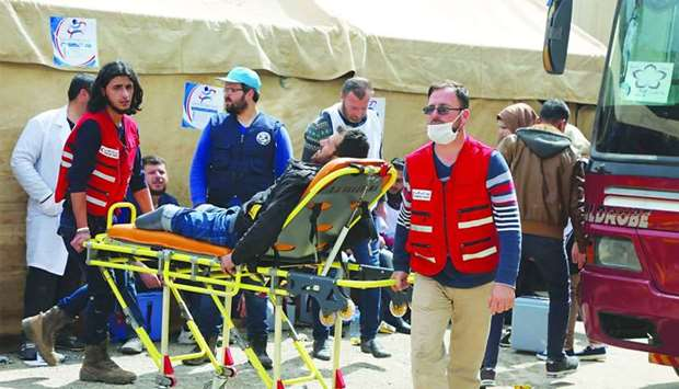 A QRCS medical team providing assistance to Syrian IDPs.