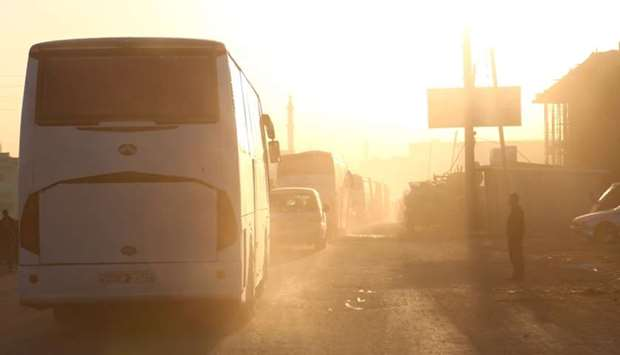 Buses carrying Jaish al-Islam fighters and their families, from the former rebel bastion's main town