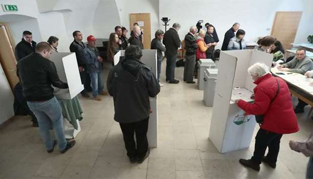 Hungarian voters cast their ballots in Gyoengyoes, 75 kms far from Budapest during the general elect