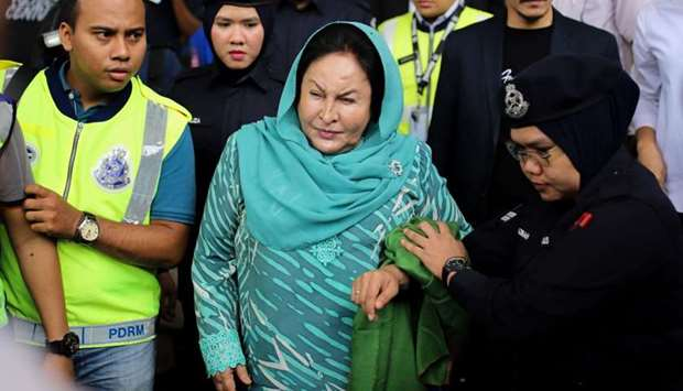 Former Malaysian prime minister Najib Razak's wife Rosmah Mansor (C) leaves the High Court after fac