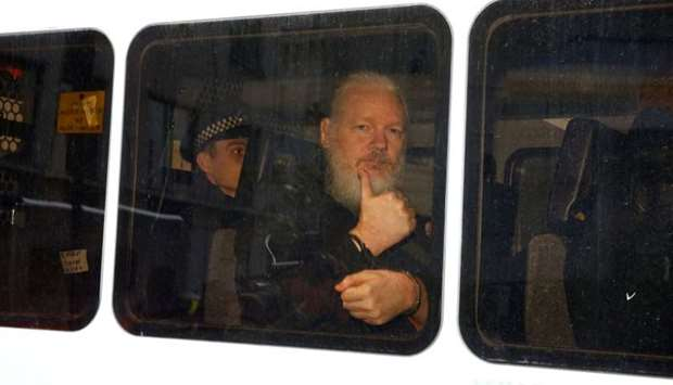 WikiLeaks founder Julian Assange is seen in a police van after was arrested by British police outsid
