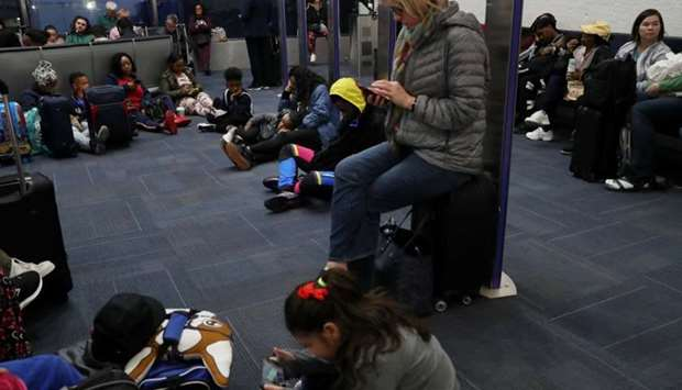 Passengers wait to board a delayed Southwest flight at Ronald Reagan Washington National airport in