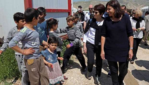 Paris' mayor Anne Hidalgo (1st-R) visits the camp for internally Yazidi displaced persons (IDP) in t