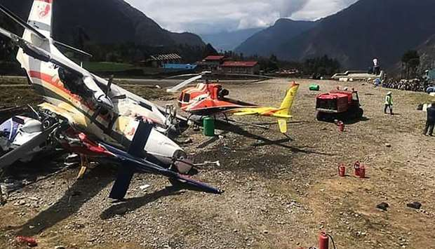 A Summit Air Let L-410 Turbolet aircraft bound for Kathmandu is seen after it hit two helicopters du
