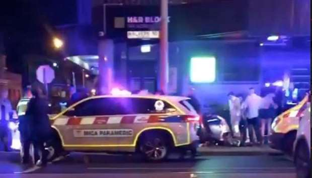 Police and rescue services are seen following a shooting incident outside a nightclub, in Prahran, M