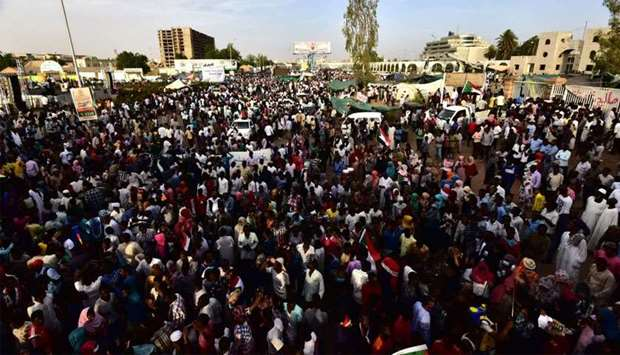 Sudanese demonstrators gather near the military headquarters in the capital Khartoum