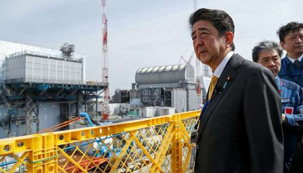 In this picture taken on April 14, 2019 Japan's Prime Minister Shinzo Abe visits the Tokyo Electric