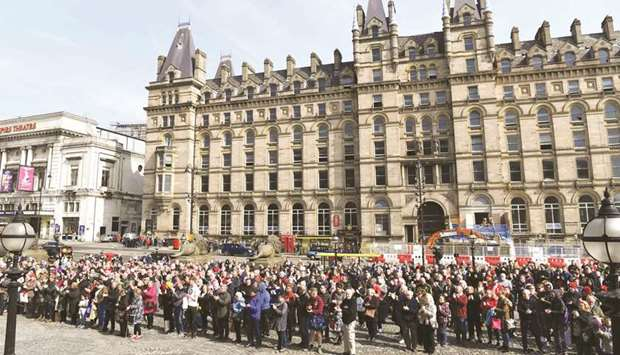 People observe a minute's silence at 3.06pm in Liverpool