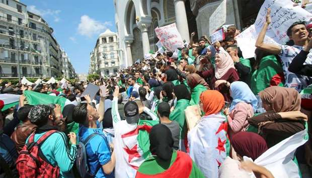 Students take part in a protest seeking the departure of the ruling elite in Algiers, Algeria