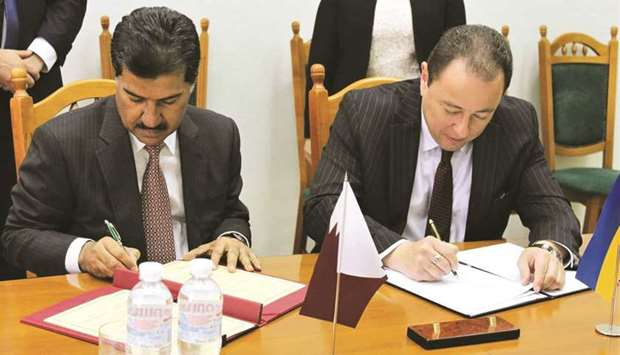 HE Dr Ahmed bin Hassan al-Hammadi and Sergiy Korsunsky signing the MoU.