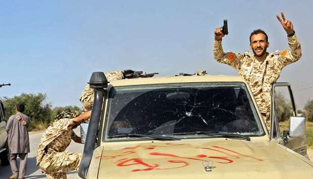 Forces loyal to Libya's Government of National Accord (GNA) gesture