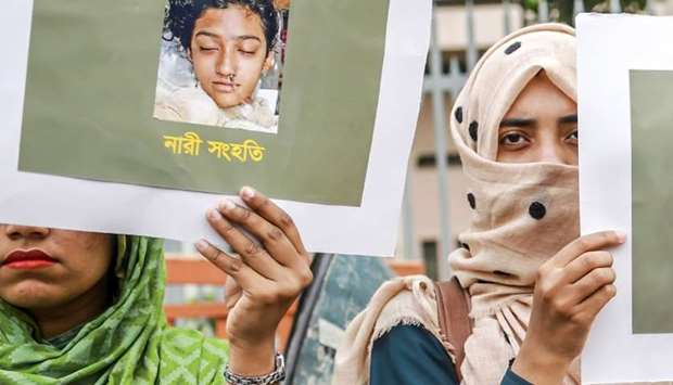 Bangladeshi women hold placards and photographs of schoolgirl Nusrat Jahan Rafi